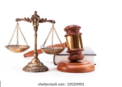 Bronze scales, gavel and book on white background