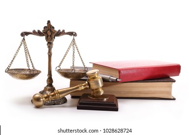 Bronze scales, gavel, books and pen on a white background