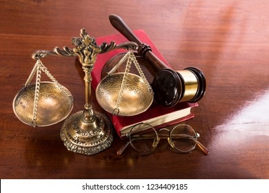 Bronze scales with saucers on chains, hammer, book of justice and glasses