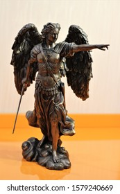 bronze sculpture of Archangel Michael with wings and sword