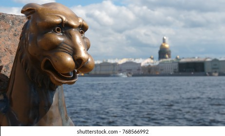 Bronze sculpture of Griffin and the Isaac's Cathedral in the summer - St Petersburg, Russia
