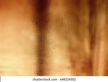 The bronze shinny abstract copper textured background