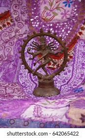 Bronze Shiva on purple - lavendar Rajasthani textile backdrop made from saris.  Nataraja (Sanskrit: Lord of Dance) Shiva represents apocalypse and creation as he dances  .