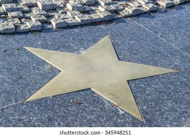 Bronze star in marble pavement Close-up horizontal view