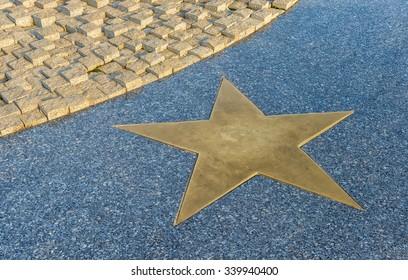 Bronze Star on the granite floor in sunset light