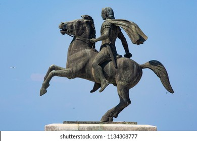 The bronze statue of Alexander the Great, King of Greeks, on his horse Bucephalus in the waterfront of Thessaloniki city. Thessaloniki, Greece - July 14, 2018
