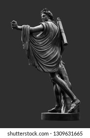Bronze statue of Apollo against dark grey background. Apollo in classical Greek and Roman mythology is a god of music, truth and prophecy, healing, the sun and light, plague and poetry.