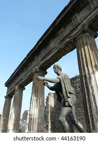 Bronze statue of Apollo in a ruined temple at the ancient Roman city of Pompeii, which was destroyed and buried by ash during the eruption of Mount Vesuvius in 79 AD