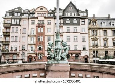 Bronze statue of children with European pastel buildings facade background in Frankfurt am main, Germany
