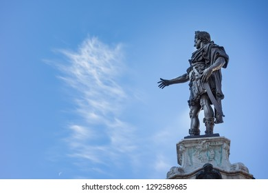 Bronze statue of Emperor Augustus in front of blue sky in Augsburg, Bavaria, Germany
