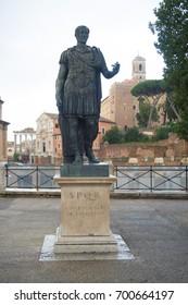 Bronze statue of emperor Julius Caesar over Temple of Venus Genetrix in Rome Italy