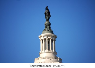 The bronze Statue of Freedom stands atop the cast iron dome of the United States Capitol building in Washington, D.C.  The dome was designed by Thomas U. Walter and the statue by Thomas Crawford.