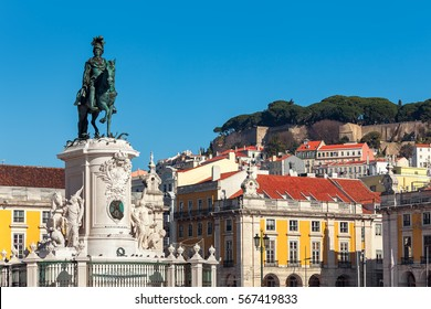 Bronze statue of King Jose on the horse, old colorful houses on background under blue sky at Commerce Square in Lisbon, Portugal.