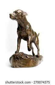 Bronze Statue of Labrador Retriever isolated on white background.