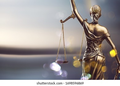 The bronze statue of lady Justice with scale