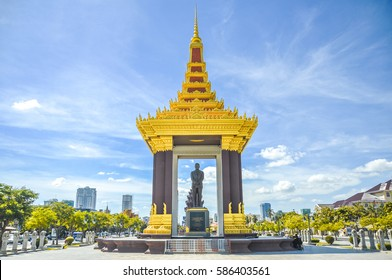 A bronze statue of the late King Father Norodom Sihanouk Statue with blue sky background at Phnom Penh