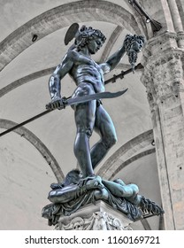 Bronze statue of Perseus with the Head of Medusa. The mythical Greek hero holding his sword in his right hand and holding up the severed head of Medusa in his left. Ancient sculptures in Florence, It