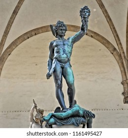 Bronze statue of Perseus with the Head of Medusa. The mythical Greek hero holding his sword in his right hand & holding up the severed head of Medusa in his left. Ancient sculptures in Florence, Italy