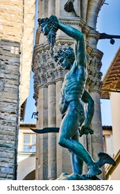 Bronze statue Perseus with the head of Medusa in front of Palazzo Vecchio in Florence, Italy