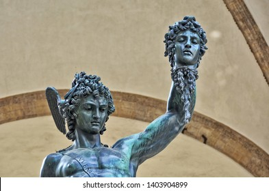 Bronze statue of Perseus with the Head of Medusa. The mythical Greek hero holding up the severed head of Medusa. Ancient sculptures in Florence, Italy