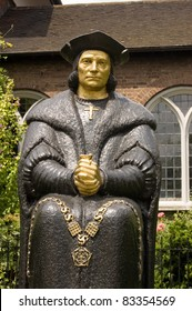 Bronze statue of the Tudor politician, considered by Catholics to be a saint, Sir Thomas More.  Next to Chelsea Old Church, London.  Sculpted by L Cubitt Bevis, erected 1969.