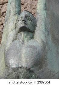 bronze statue of a winged man at Hoover Dam