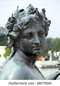 Bronze statue of woman in Versailles Chateau gardens. France