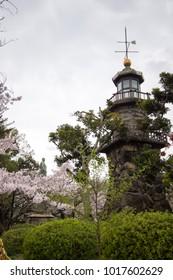 Bronze statue of Yajiro Shinagawa and cherry trees at Kudan slope Park near Chidorigafuchi walkway,Chiyoda,Tokyo,Japan.