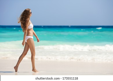 Bronze Tan Woman At Tropical Beach