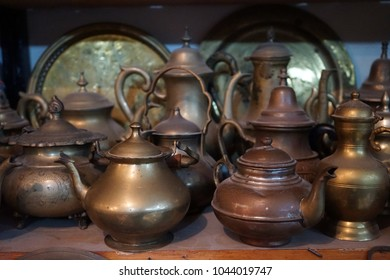 Bronze tea pots on the shelf