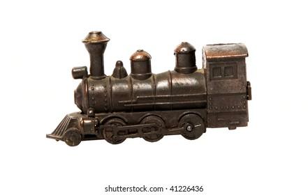 Bronze train over white background. Isolated object. retro image