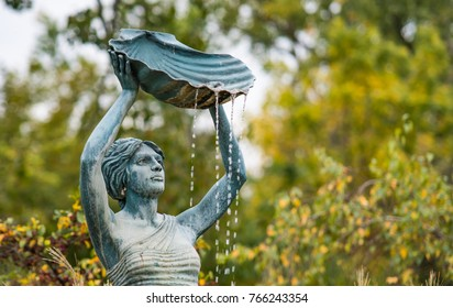 Bronze Water Fountain Sculpture of a Black Woman Holding a Sea Shell