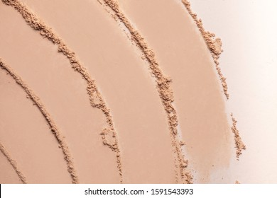 Bronzer or blusher and compact powder  brown nude smudge white isolated background