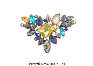 brooch with colored gems isolated on white