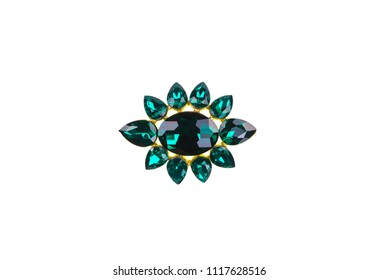brooch with emeralds on a white background