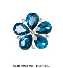brooch flower with blue stones isolated on white