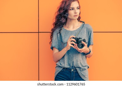Broody Hipster Girl Photographer Looking Away With Vintage Film Camera In Her Hands Try To Fing Any Original Things To Take Photo, Copyspace