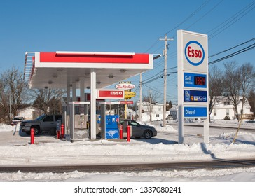 Brookfield, Canada - January 04, 2014: Esso gas station during Winter. Esso is one of the brand names for ExxonMobil along with Exxon and Mobil.
