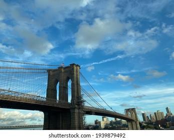 Brooklyn bridge against a blue sky