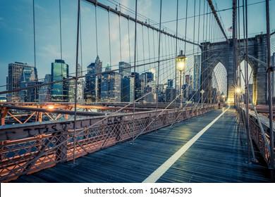 The Brooklyn Bridge by night, NYC.