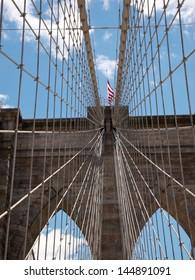 Brooklyn Bridge details against blue sky. New York City.