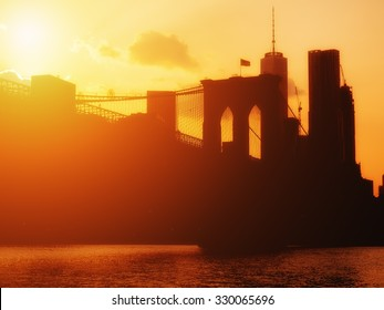 The  Brooklyn Bridge and the downtown Manhattan skyline at sunset