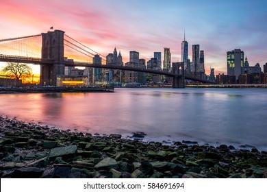 Brooklyn Bridge and Downtown Manhattan view from Brooklyn Bridge Park at sunset