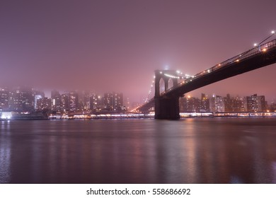 Brooklyn Bridge at foggy night, New York, winter 2016
