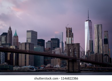 Brooklyn Bridge and Lower Manhattan, New York at dawn featuring New York skyline and Freedom Tower.