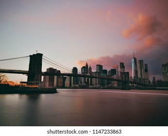 Brooklyn Bridge and Lower Manhattan Skyline, New York at dawn. Shot from Dumbo, Brooklyn.