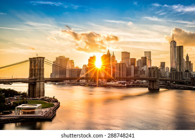 Brooklyn Bridge and the Lower Manhattan skyline at sunset, as viewed from Manhattan Bridge