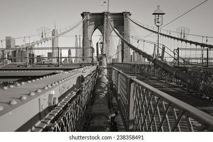 The Brooklyn Bridge with manhattan in the back ground in black and white.