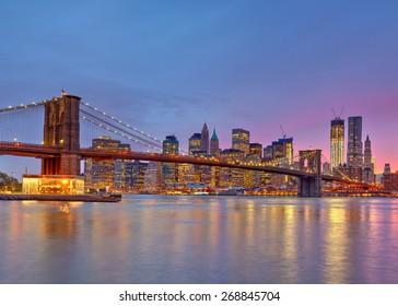 Brooklyn bridge and Manhattan at dusk, New York City