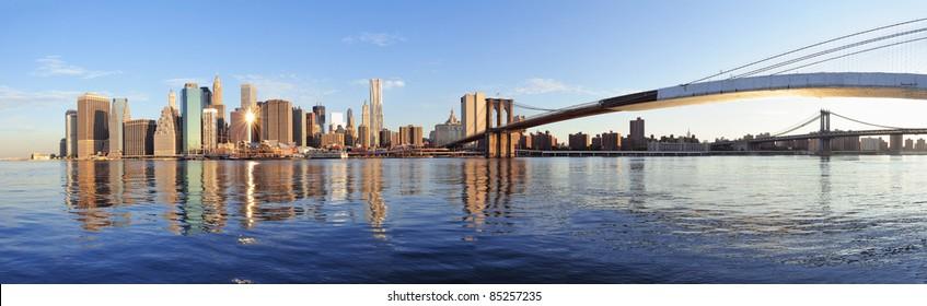 Brooklyn Bridge and Manhattan Bridge with lower Manhattan skyline panorama over East River in New York City